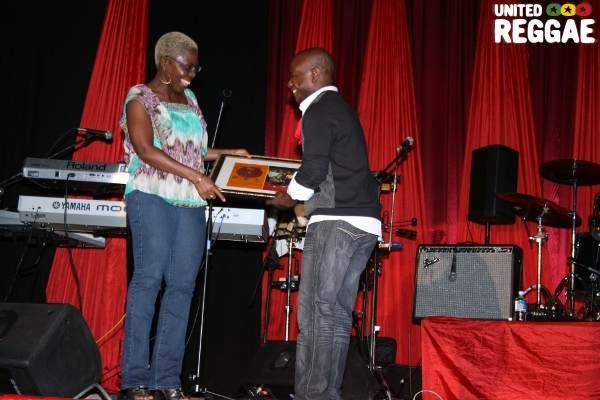 Joylene Griffiths-Irving collects gift from band member © Steve James