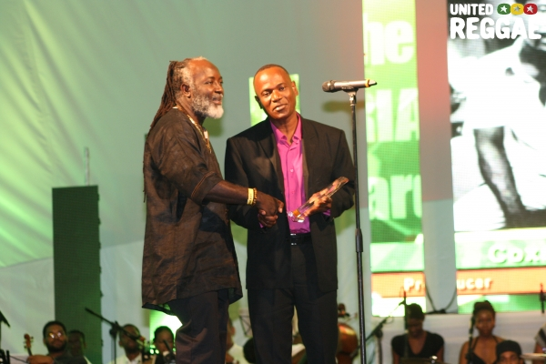 Freddie McGregor presents award to Courtney Dodd on behalf of his father Clement Dodd © Steve James