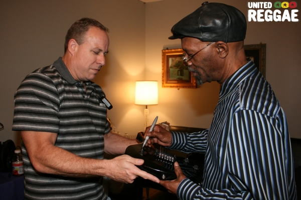 Beres Hammond signs guitar for manager of the venue, David Gold © Steve James