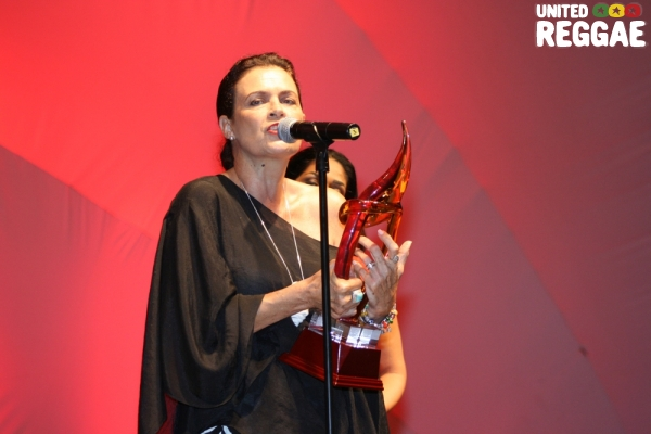 Cindy Breakspeare collect award on behalf of her son, Damian Marley © Steve James