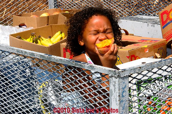 Child with peach © Sista Irie