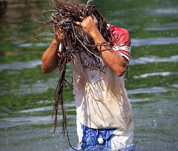 Dread washing hair in the river in Alligator Pond © Sista Irie