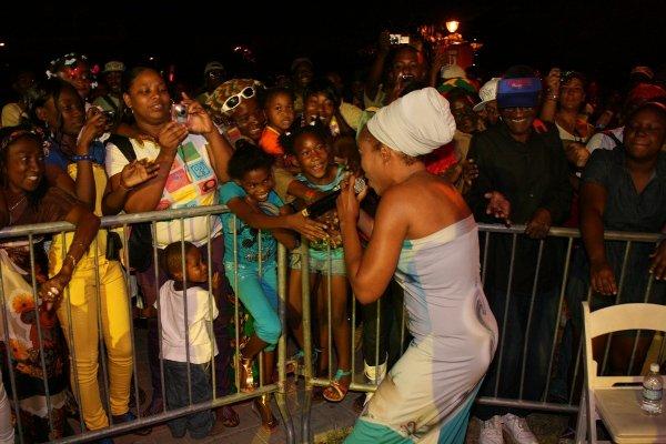 Queen Ifrica singing to her fans © Steve James